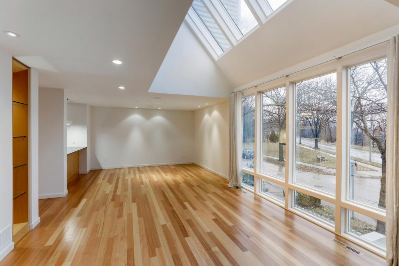 Before Image - Large Empty Room with Hardwood Floors
