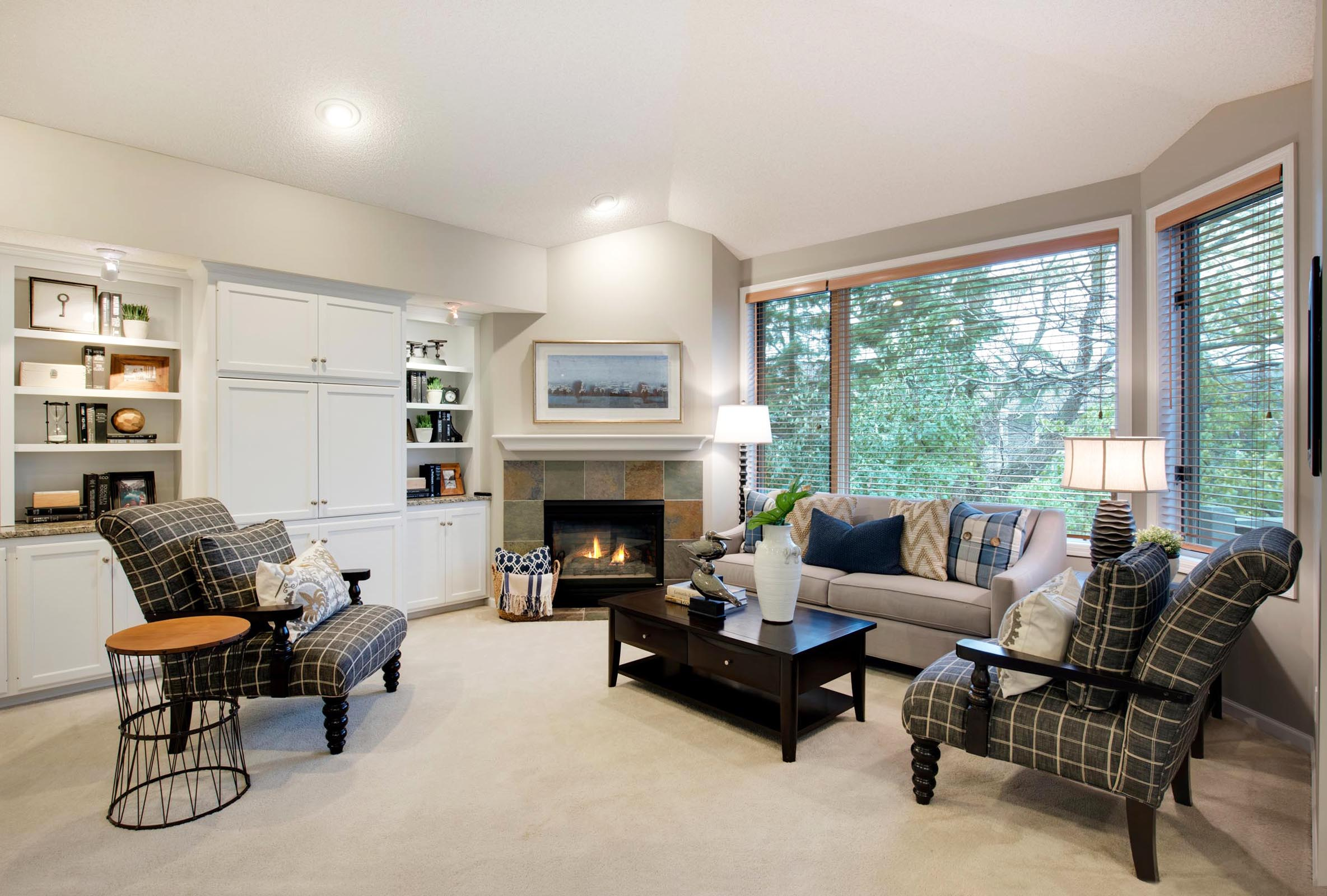 Cozy furnished room around an inviting hearth